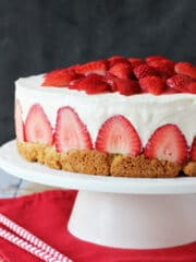 Strawberry Shortcake Cheesecake on white stand