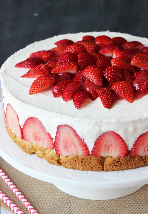 Strawberry Shortcake Cheesecake - shortcake topped with strawberries, no bake vanilla cheesecake and whipped cream!