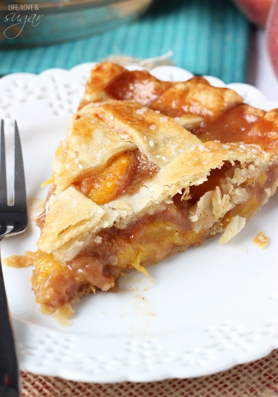 Close up of a slice of pie with peaches in the middle