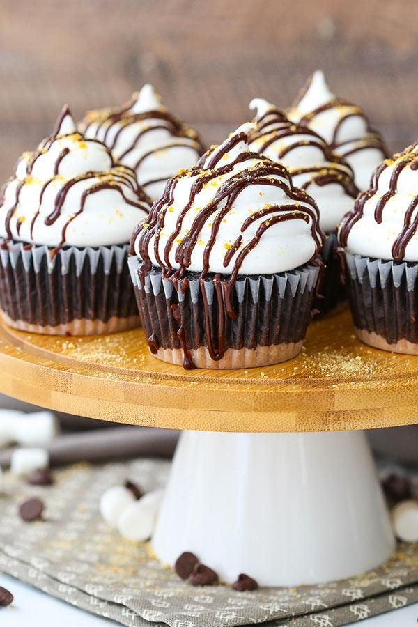 Smores Cupcakes on a wooden pedestal