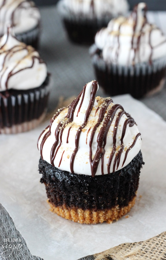 S'mores Cupcakes - super moist chocolate cupcakes with a graham cracker crust, topped with a light marshmallow frosting!