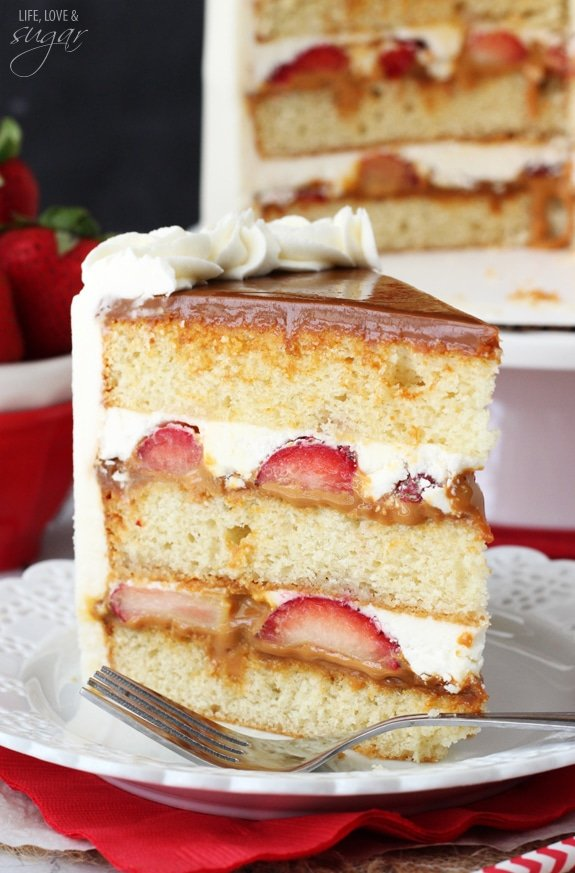 Strawberry Dulce De Leche Cake - layers of moist vanilla cake, dulce de leche, fresh strawberries and vanilla buttercream! A delicious combo!