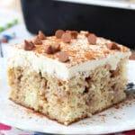 Cinnamon Roll Poke Cake on white plate
