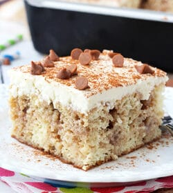 Cinnamon Roll Poke Cake on white plate