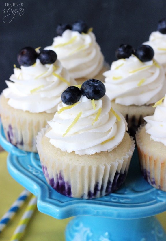 Lemon Blueberry Cupcakes on a blue cake stand