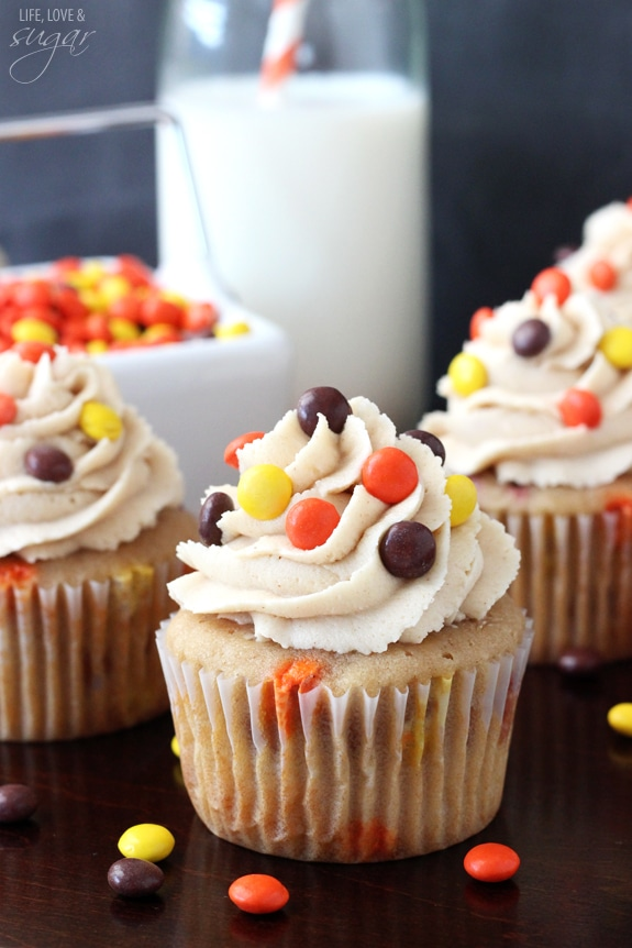 Triple Peanut Butter Cupcakes - peanut butter cupcake filled with mini reese's pieces and peanut butter chips, topped with peanut butter icing!