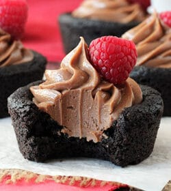Nutella Cheesecake Chocolate Cookie Cups with bite missing