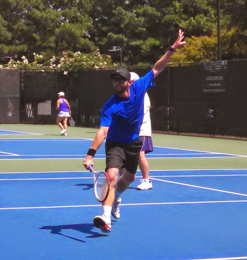 An Action Shot of Ian Playing Tennis