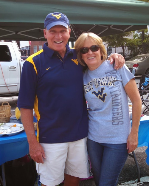 Lindsay's Parents Smiling with their Arms Around Each Other at the Tailgate
