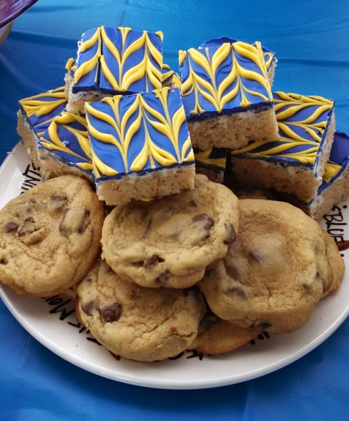 Chocolate Chip Cookies and Blue & Gold Frosted Rice Krispie Treats on a Plate
