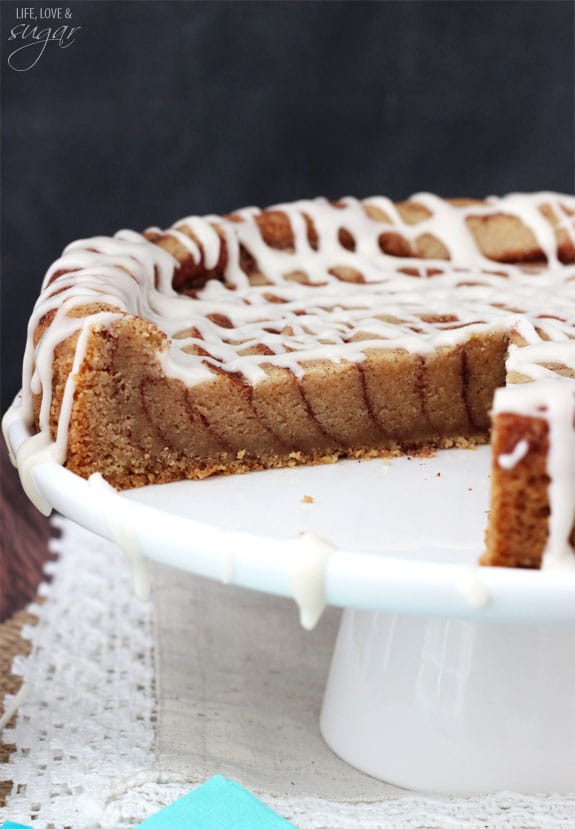 A Giant Cinnamon Roll Cookie Cake on a Cake Platter