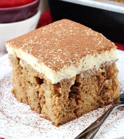 Tiramisu Poke Cake on white plate