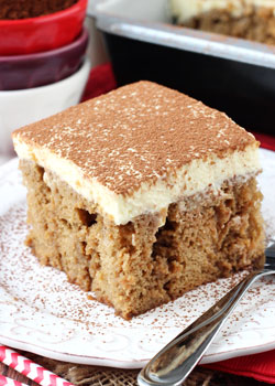Tiramisu Poke Cake on white plate