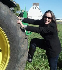Lindsay with John Deere tractor