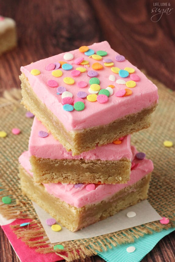 Pink Frosted Sugar Cookie Bars in a stack