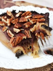 Caramel Turtle Pie Slice on white plate with bite on fork close up