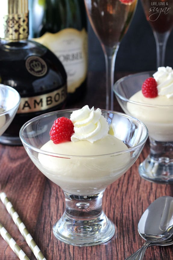 Champagne Mousse in glasses topped with raspberries and whipped cream