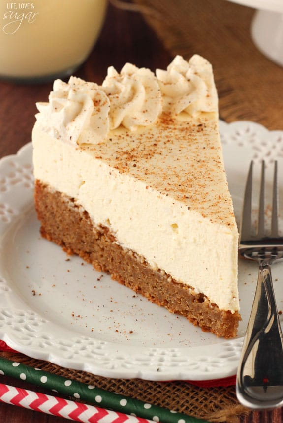Slice of eggnog cheesecake on a white plate