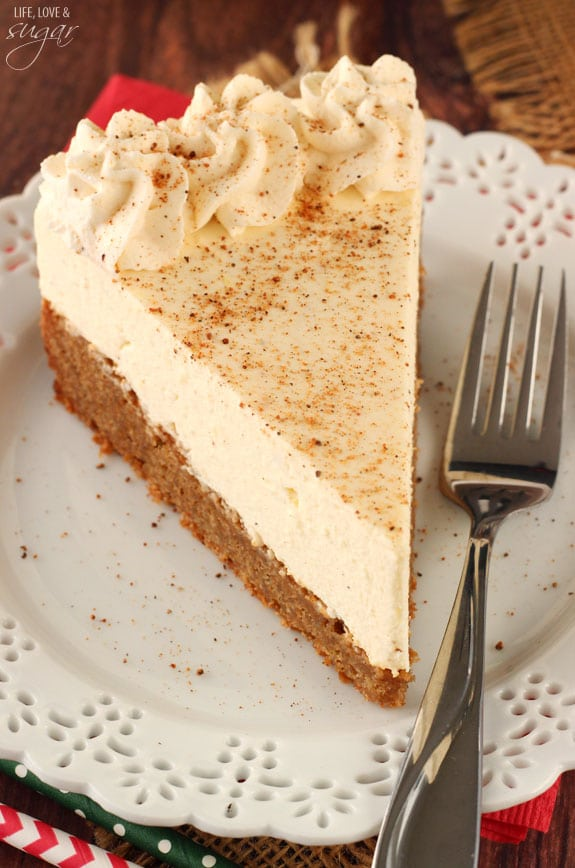 Slice of eggnog cheesecake on a plate with fork.