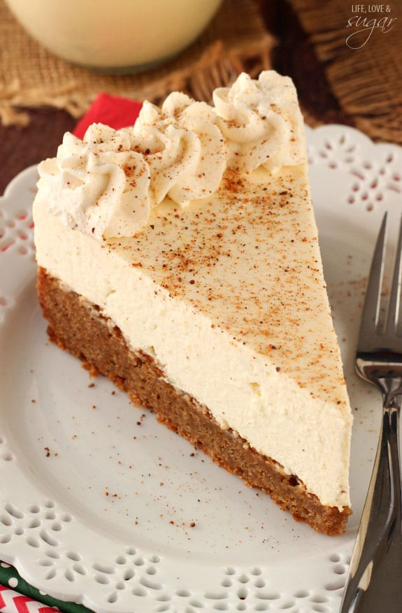 Slice of eggnog cheesecake sprinkled with nutmeg.