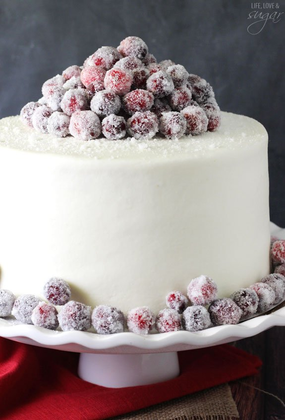 Sparkling Cranberry White Chocolate Cake - super moist vanilla cake full of fresh cranberries iced & How to frost a smooth cake with buttercream - Life Love and Sugar