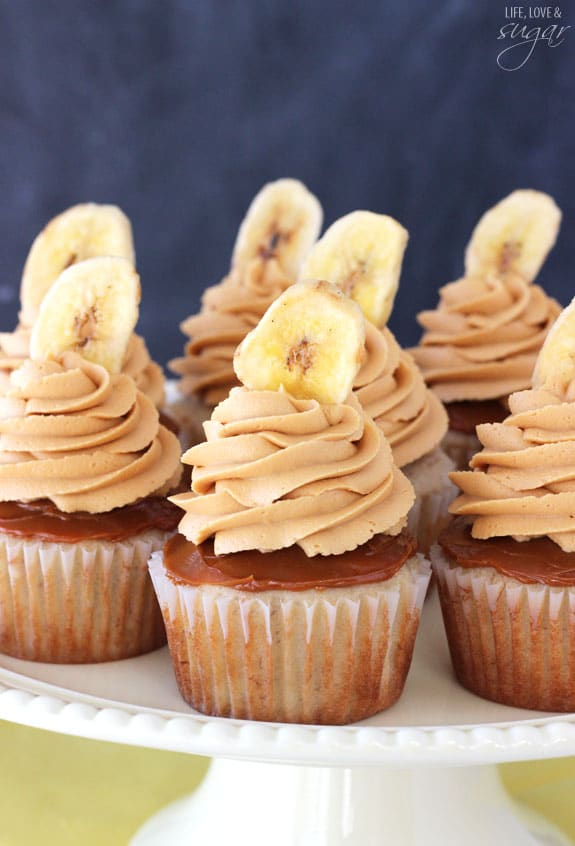 Banoffee Cupcakes - moist banana cupcake, with a layer of dulce de leche, finished off with dulde leche icing and a banana chip!