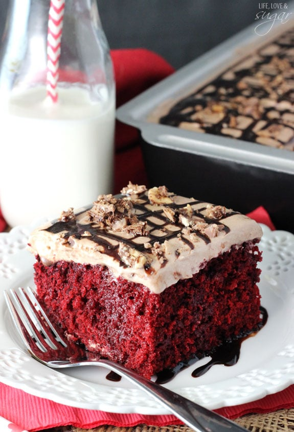 Nutella Red Velvet Poke Cake - red velvet cake soaked with sweetened condensed milk and Nutella! Topped with Nutella whipped cream!