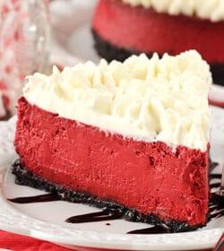 Red Velvet Cheesecake slice on white plate