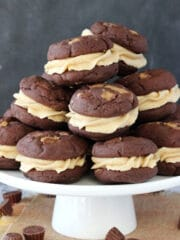 Reese's Peanut Butter Chocolate Cookie Sandwiches on white stand