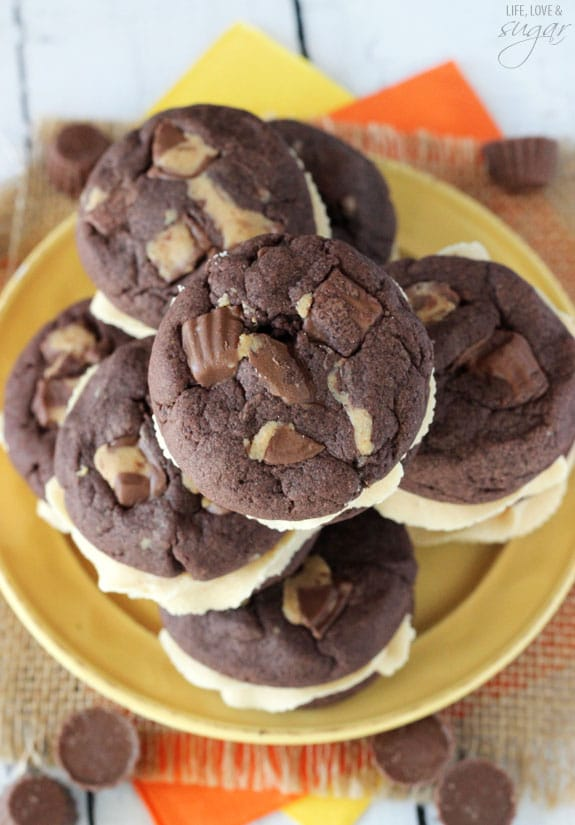 Top view of Reese's Peanut Butter Chocolate Cookie Sandwiches stacked on a yellow plate