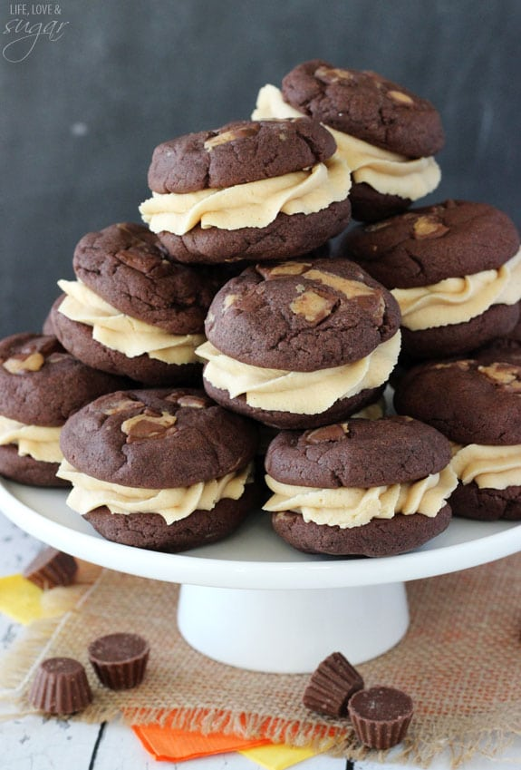 Chocolate Cookie Sandwiches stacked on a white cake stand
