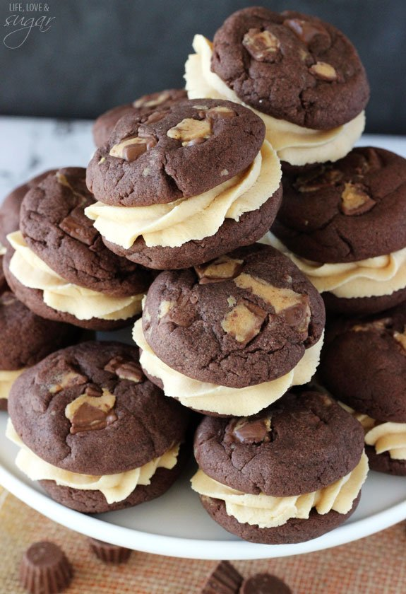 Reese's Peanut Butter Chocolate Cookie Sandwiches stacked on white stand