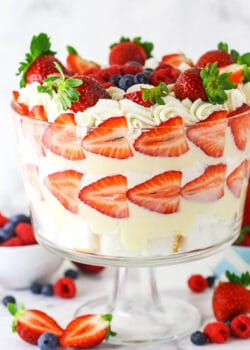 Triple Berry Trifle in clear trifle dish with berries around the bottom