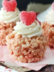 A Valentine's Day Rice Krispie Treat Cupcake on a pink napkin