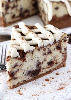 Cinnamon Roll Cheesecake slice on white plate