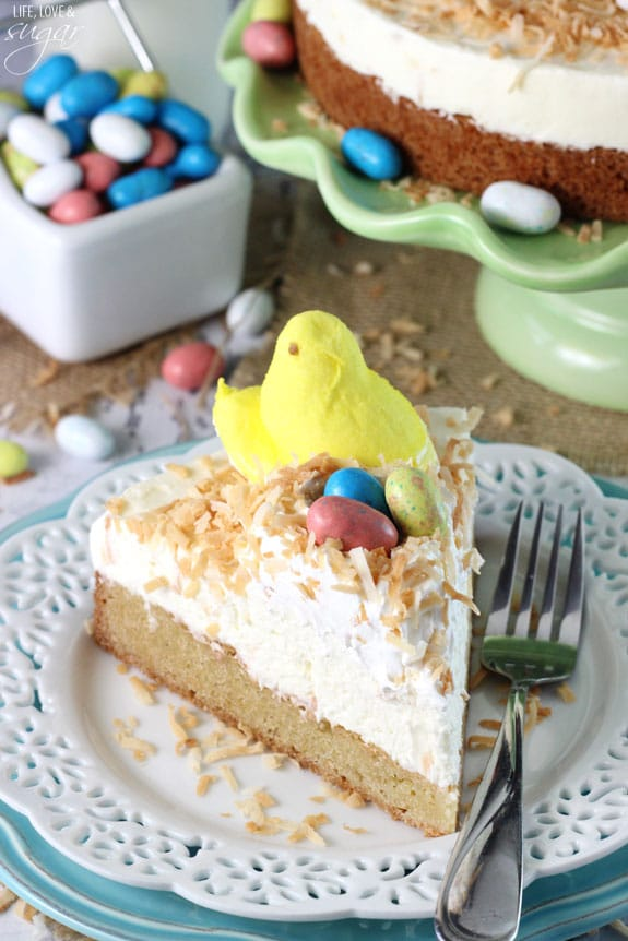 Coconut Blondie Cheesecake - a coconut blondie topped with no bake coconut cheesecake and toasted coconut! Perfect dessert recipe for Easter with Peeps!