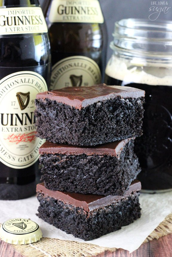 Guinness Brownies - super moist and chewy brownies! A delicious mix between cake and fudgy! You won't be able to stop eating them!