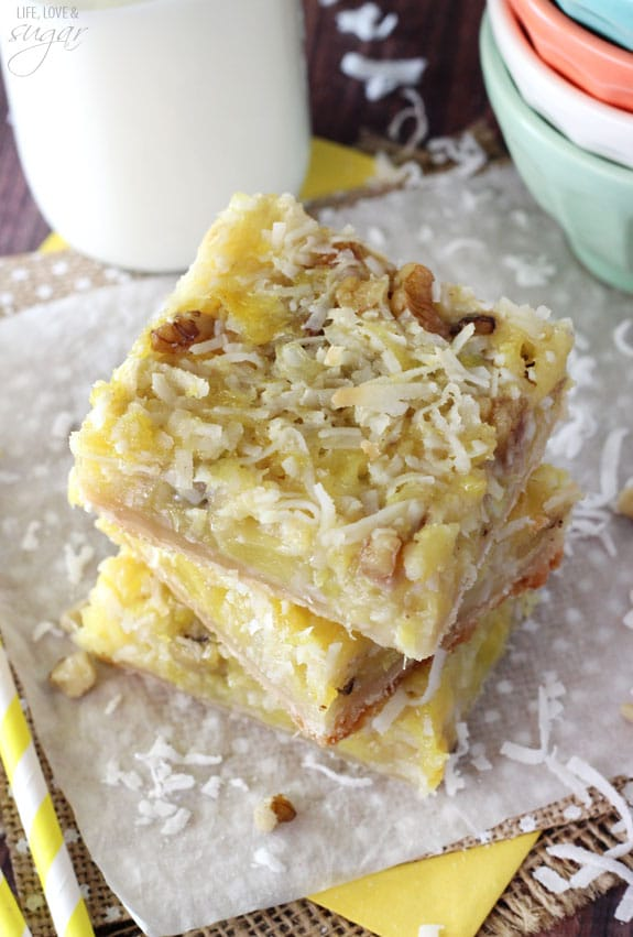Pineapple Coconut Bars stacked on a napkin