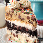 Ultimate Chocolate Chip Cookie Layer Cake slice on white plate