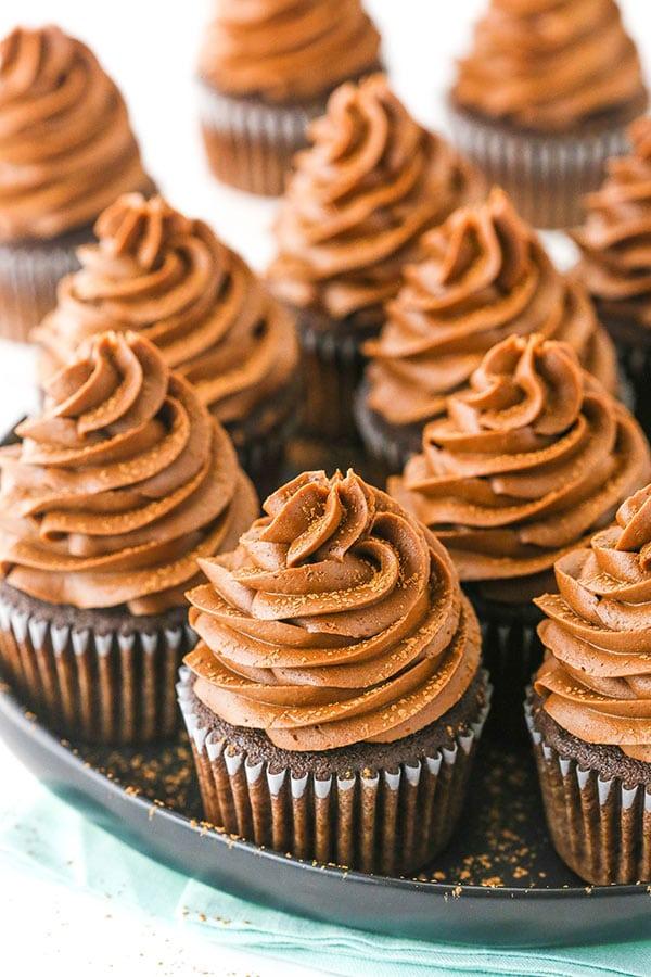 chocolate cupcakes on black platter
