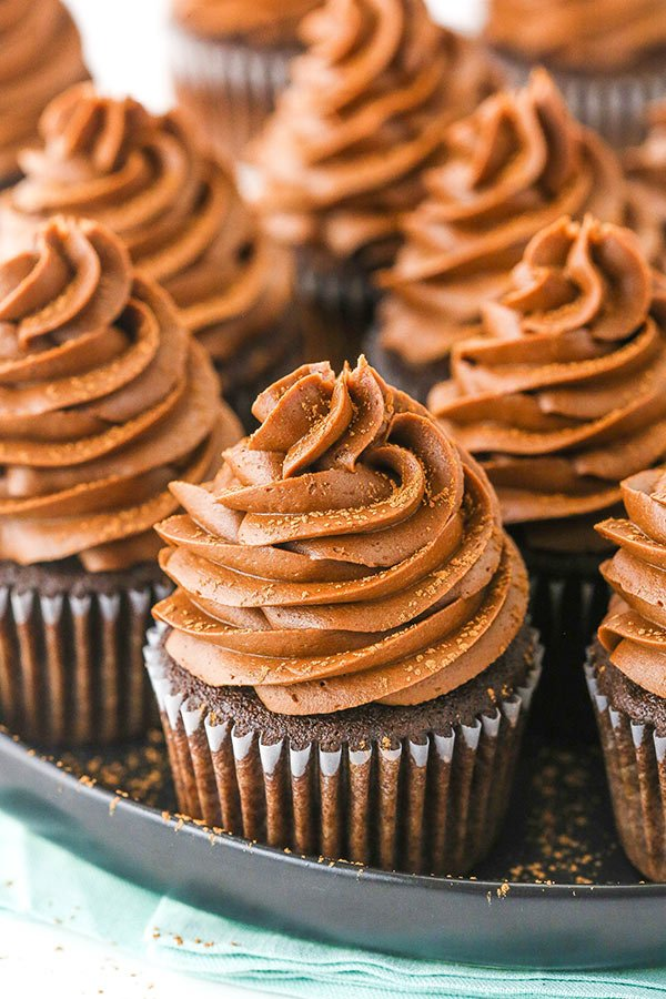 close up of chocolate cupcake on black platter