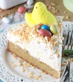 Coconut Blondie Cheesecake slice on white plate