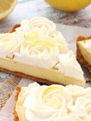 Creamy Lemon Tart with slice being removed close up