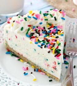 No Bake Funfetti Cheesecake slice on white plate