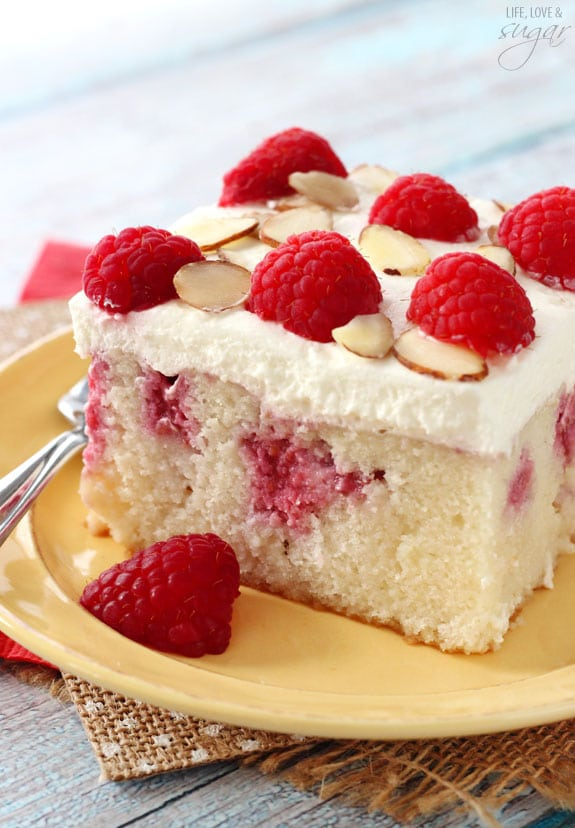 Raspberry Almond Poke Cake - almond cake soaked with sweetened condensed milk and raspberry puree, then topped with almond whipped cream!