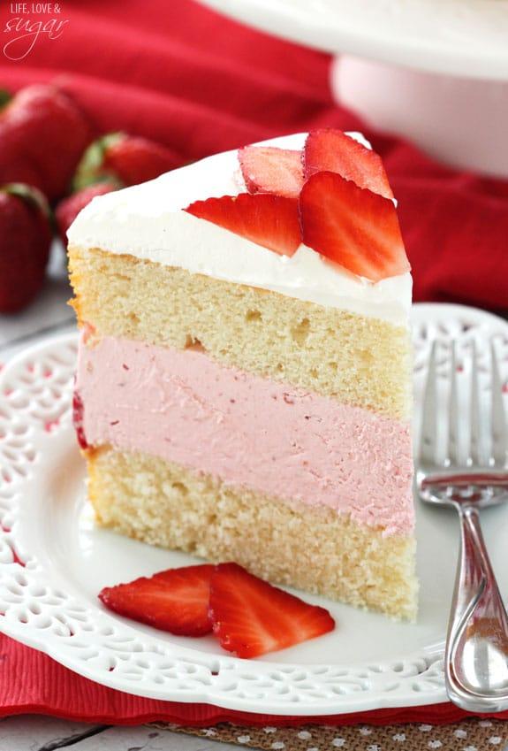 ... Ice Cream Cake! Layers of soft vanilla cake with creamy strawberry ice