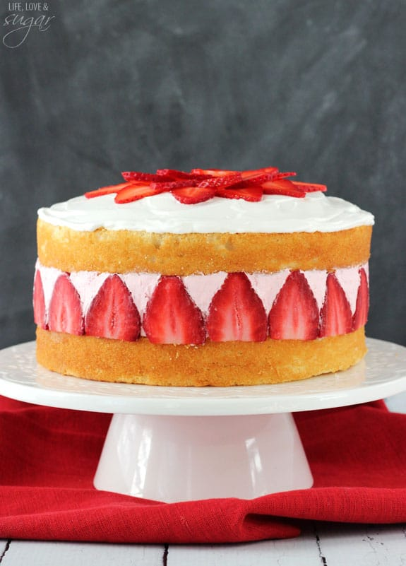 Strawberry Ice Cream Cake! Layers of soft vanilla cake with creamy strawberry ice cream!