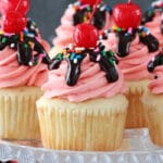 Strawberry Sundae Cupcakes on glass stand close up