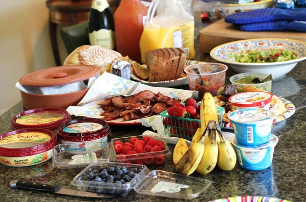 Berries, Bananas, Bread, Hummus and Other Breakfast Items on a Countertop