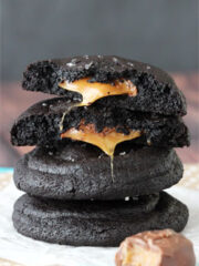 Salted Caramel Stuffed Chocolate Cookies stacked with top cookie halved